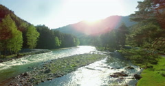 4k UHD aerial view. Low flight over fresh cold mountain river at sunny summer - stock footage