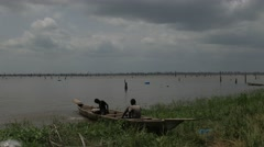 Africa Ghana lake kids draining boat 4K Stock Footage