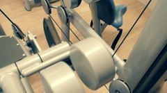 Various exercise equipment in the fitness club Stock Footage