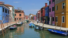 Venetian lagoon - Burano island - Colorful houses reflecting in the canal Stock Footage