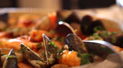 Smoke emitting from seafood rice just done in a restaurant - stock footage