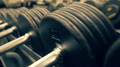 Rows of dumbbells in modern sports club Stock Footage
