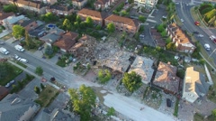 Drone flying towards house in debris after major blast - stock footage