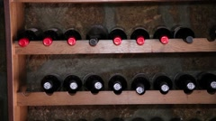 wine cellar with bottles of vintage wine - stock footage