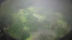 Steam from pan cooking broccoli Stock Footage