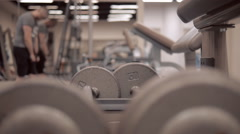 Barbell in modern sport gym on a background of the training member of the club Stock Footage