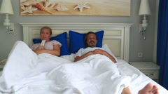 Happy couple lying and watching tv 5 Stock Footage