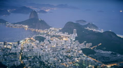 medium night time shot of botafogo and sugarloaf mountain in rio - stock footage