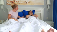 Unhappy couple fighting in bed room Stock Footage