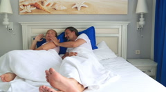 Unhappy couple fighting in bed room 3 Stock Footage