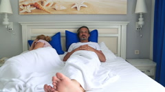 Unhappy couple fighting in bed room 4 Stock Footage