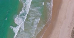 Turquoise water and wave crashing on sandy beach Stock Footage