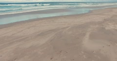 Waves and sand Stock Footage