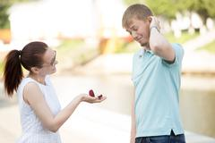 A woman making proposal to boyfriend Stock Photos