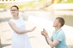A woman refusing her boyfriend to marry after being proposed Stock Photos