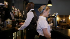 4K Cheerful team of bar staff working together in fashionable city bar Stock Footage