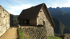 A reconstructed hut at machu picchu on a sunny morning Stock Footage