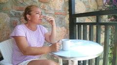 Blonde sad woman smoking on the balcony - stock footage
