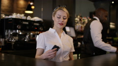 4K Portrait smiling team of bar staff working together in fashionable city bar Stock Footage