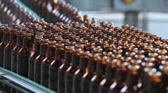 Flow bottles on the line. Automatic supply of bottles on the bottling line Stock Footage