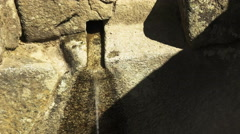 Close up of a stone water fountain at machu picchu Stock Footage