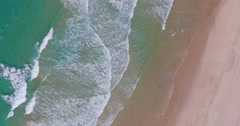 Birds eye view of rolling waves at the beach Stock Footage