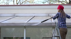 Exterior washing and building cleaning glass roof with high pressure water jet Stock Footage