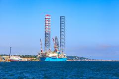Jack up oil drilling rig in the shipyard for maintenance in Dundee, Scotland, - stock photo