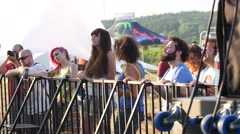 Fans by stage shake heads and hairs enjoy listen to brutal metal music open air - stock footage