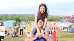 Cute little child girl sit on father shoulders dance enjoy open air music fest Stock Footage