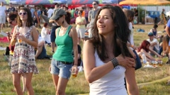 Be happy and dance - young girls fans spectators by open air music stage Stock Footage