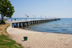 Beach and Pier at Baltic Sea in Gdynia Orlowo - stock photo
