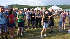 Drink beer and dance - young fans spectators by open air fest music stage Stock Footage
