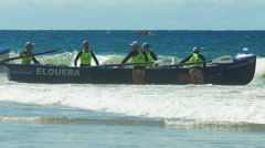 cheeky clip of a surf boat crew on the sunshine coast of australia - stock footage