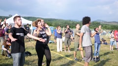 Open air music concert festival spectators young people clapping hands by stage Stock Footage