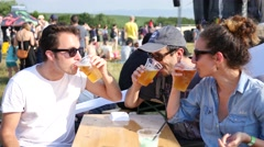 Guys friends young people group drinking beer rest on open air music festival Stock Footage