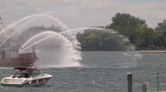 Toronto fire department fire boat with firefighters spraying water Stock Footage