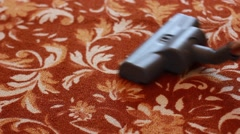 Vacuum cleaner cleaning the carpet Stock Footage