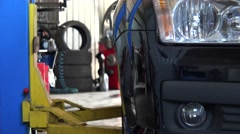 Car lift up a car in service station garage Stock Footage