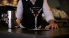 4K Bartender prepares & serves a fresh cocktail for customer. Stock Footage
