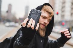 Stylish bearded man taking a selfie Stock Photos