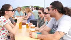 Guys friends young people group drinking beer rest open air have fun Stock Footage