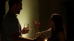 Young Man and Woman telling funny stories at bar while drinking - stock footage