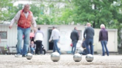 Seniors Playing Petanque in the Boules Court Stock Footage