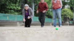 Seniors Playing Petanque In The Park Stock Footage