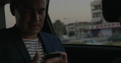 Man using smart phone in the car Stock Footage