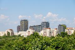 Bucharest City Skyline View Over Central Public Park Trees - stock photo