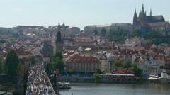 Crowd of people walking through the Charles bridge in Prague Stock Footage