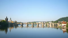 Charles bridge and Vltava river at early morning in Prague - stock footage
