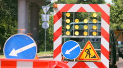 Warning signs and lights on the road Stock Footage
